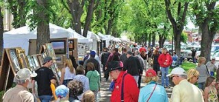 People fill the courthouse plaza for the 2014 Phippen Museum Western Art Show and Sale in downtown Prescott.  - att Hinshaw/The Daily Courier